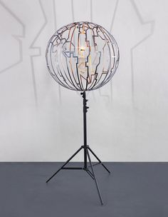 Olafur Eliasson Timezone Lamp, 2008  stainless steel, tripod, glass gas lamp with wick Overall 81 3/8 x 35 1/2 x 35 1/2 in. (206.8 x 90.3 x 90.3 cm.) Globe element 34 7/8 x 35 1/2 x 35 1/2 in. (88.5 x 90.3 x 90.3 cm.)