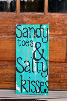 "Wooden Signs, Wood Signs, Beach Art, Distressed Beach Sign Wood Art Sign: ""Sandy Toes & Salty Kisses"". $49.00, via Etsy."