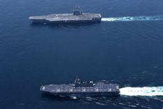 18.05 Deux porte-avions américain et japonais dans les eaux japonaises.Photo: Reuters/Handout