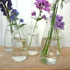 Mini Milk Bottle Vase Small bottle measures approx 10cm high. Large bottle measures approx 14cm high £3.95.
