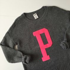 "⭐️HP⭐️ VS PINK Limited Edition Knit Sweater LIMITED EDITION Victoria's Secret PINK woven knit sweater with ""P"" Varsity Letter. Fits oversized! This was barely worn, so it's still in great condition! Does have a slight fuzz, but that's because of the wool. 70% acrylic 30% wool. About 25"" long, 20"" wide, and sleeves 17 1/2"" long. It is stretchy! NO TRADES. PINK Victoria's Secret Sweaters"
