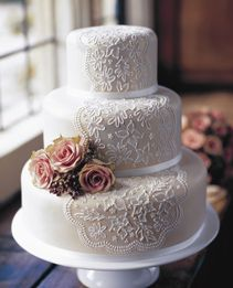 Elegant lace veil wedding cake - so much more tasteful than the busy, cheap swirlsthat so many people favour!