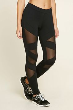 A pair of stretch-knit athletic leggings featuring zigzag mesh inserts.