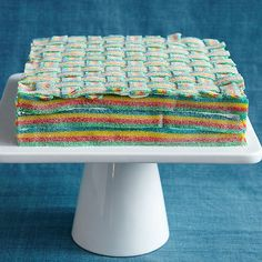 Cover any cake with rainbow sour candies to create a colorful basket weave pattern.