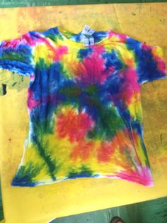 Tie Dying with toddlers - this is a finish project before it is left to settle for 24 hrs.  Then we rinse and wash them.