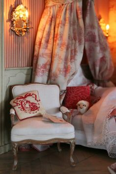 Dreamy, French-inspired girl's room - needlepoint pillow, striped walls, toile crown, sconces