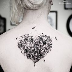 Breathtaking flowery heart blackwork tattoo.  Diana Severinenko's nature tattoos capture the beauty and essence of flowers, animals and nature scenes in a unique blend of tattooing styles. Enjoy!