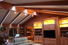 LED strips built into the wood on the ceiling. Awesome.