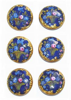 Late 19th C. Set of six hand painted enamel buttons, each with a basket of flowers surrounded by an ornate gold border.