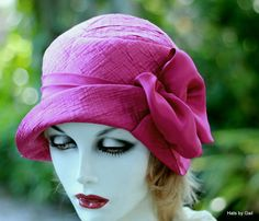 A great looking hat for a dressy hat for the opera or special event? This heavy textured bright hot pink/fuchsia fabric cloche is a great pick for you. I chose to decorate the hat with a simple complimentary fuchsia pleated band and flounce. The h...