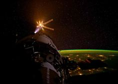 Snorting fire from it's nozzles, a European Space Agency un-piloted cargo vehicle approaches the International Space Station