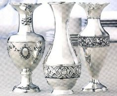 This stunning Silverplated Set of Vases are constructed of heavy cast silverplate in 3 assorted designs, each with intricate embossed detail. Bud Vases, Tabletop, Silver Plate, Exotic, Art Deco, Spirit, Holiday, House, Design