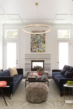 blue velvet sofas, and that halo chandelier!