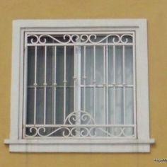 Ventanas con rejas de herrería residencial