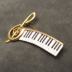 Treble clef piano keys pin for a 'lady.'