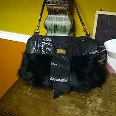 Bill Blass Fox Fur leather bag Gorgeous soft real fox fur bag with a beautiful black suede leather snake print. In excellent condition.  11 inch strap drop. Removable strap. Bill Blass Bags Satchels