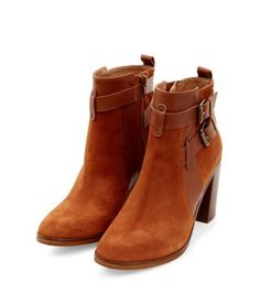 Boots aren't just for winter. These Light Brown Premium Leather Buckle Strap Block Heel Ankle Boots will work just as well with floral summer skirts and denim shorts.