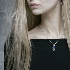 Xyanya necklace possesses silvery streaks of hematite that pierce the night sky in this deep blue Lapis stone. Set against gentle curves and angular triangles Xyanya is all at once large and dramatic yet delicate and light. Let the dark heavens reflect the sparkle of your soul.  #ZoeAndMorgan #Jewellery #Beautiful #Lapis #Love