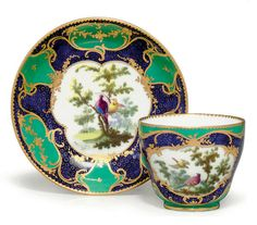A SEVRES PORCELAIN BLEU LAPIS AND GREEN GROUND CUP AND SAUCER (GOBELET 'HERBERT' ET SOUCOUPE, 2EME GRANDEUR) CIRCA 1758, BLUE INTERLACED L'S MARK, THE CUP WITH TWO BLUE DOTS TO THE FOOTRIM LIKELY FOR THE GROUND PAINTER, INCISED CS AND T, THE SAUCER INCISED I