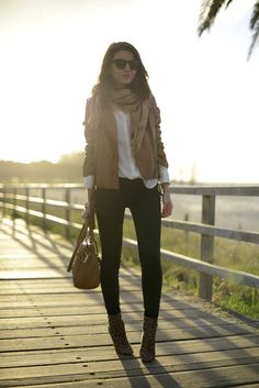 Tan leather jacket and black pants