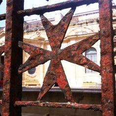 Rusty Maltese Cross
