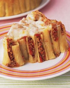 "Baked Ziti with Ground Beef | Martha Stewart Living - This savory ""cake"" is packed with pasta, meaty tomato sauce, and cheese. A springform pan allows it to hold its shape. It takes only a few minutes to pack the ziti into the pan for this dish."