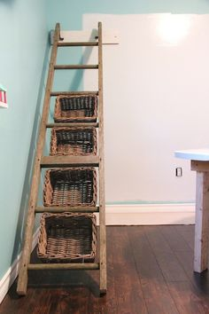 Ladder storage bin - would be perfect for downstairs (toys, mittens, etc.)