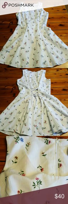 🔷SALE!!🔷Vintage mini dress Adorable white mini dress with printed flower design.  Zipper on back with criss cross tie back.  Has a light pink discoloration around the neck and bottom left, but not noticeable. D.B.Y. Ltd. Dresses Mini