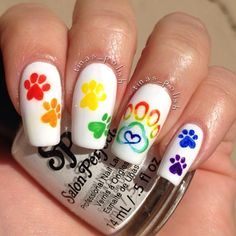 """My day 7: paw prints for #randomnailartapr found the rainbow paw print design on google."" Photo taken by @tinas_polish on Instagram, pinned via the InstaPin iOS App! http://www.instapinapp.com (04/07/2014)"