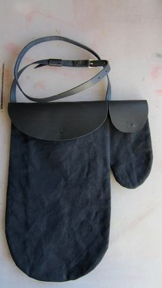 Canvas bag, black, irregular cut, with a small bag attached to the side. €69.00, via Etsy.