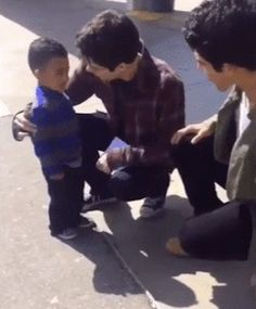 dylan o'brien and tyler posey with a little fan on set gif - BTS Season 6 filming