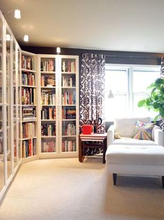 House Crashing: Lovely At Last | Young House Love. Love this shelving. they look like Billy to me with doors and an IKEA lighting system. I would love to do this with my place, but have the doors that only cover the bottom half so I can store other things in there (tools, linens, etc. as I don't have built in storage for any of these).