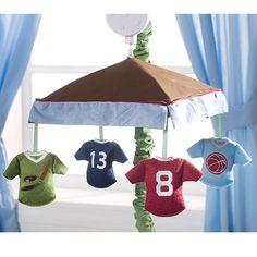 Sports Mobile .... could definitely see this is a nursery with different Bronco player's jerseys lol