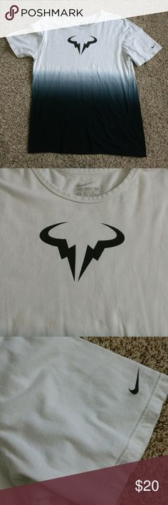 The Nike Tee White Black Gray Athletic Cut Tee L Gently used before hand. No tears or holes.  TAG SIZE: Large  Perfect for casual wear, during the summer and or spring. Would look great on khakis and or during a gathering.  Length:  21 inches armpit to armpit & 28 inches shoulder to base  Color - Multi-color, primarily white, black, and grey.  Fabric - 100% Cotton Nike Shirts Tees - Short Sleeve