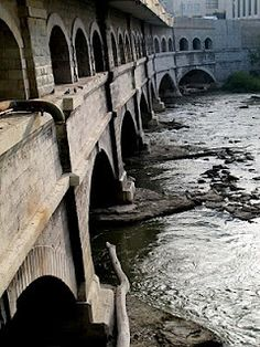 In  Rochester, NY - the Broad St. bridge (over the Genesee River) which contains a portion of Rochester's abandoned subway tunnel; before the subway was built, it was an Erie Canal aqueduct