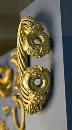 The Great Torc, Snettisham, buried around 100 BC. The torc is one of the most elaborate golden objects from the ancient world. It is made from gold mixed with silver and weighs over 1 kg. Torcs are made from complex threads of metal, grouped into ropes and twisted around each other. The ends of the torc were gast in moulds and welded onto the metal ropes. - See more at: http://realmsofgoldthenovel.blogspot.com/2014/04/the-snettisham-hoard.html#sthash.ODJT7Esy.dpuf