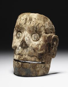 Aztec skull mask, Late Postclassic, wood, white ground with traces of black and red paint.