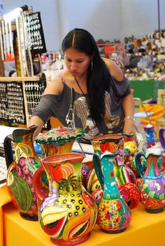 Woman selling pottery items at the Feria de Texcoco, Texcoco, Mexico State