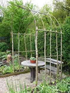 Birch verticals and horizontals screwed together to make an arbour. Flexible willow forms the arch. Making your own supports, ideally on the spot, means that you can tailor them to the size and shape you require. Supports from garden centers are designed to fit on the top of a car and are rarely tall enough for vigorous climbers.