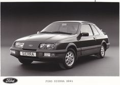 1983 Ford Sierra XR4i. Following the launch of Sierra in 1982, the XR4i version came in 1983, complete with 2.8 injection engine. Available only as a 3 door version, it also featured a smaller version of the whale tail spoiler which was later to appear on the Cosworth