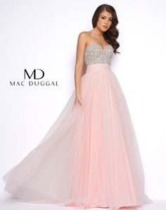 Empire waist pink prom dress with embellished top. Style features a strapless  beaded bodice with gathered tulle overskirt. ff28d3ea3