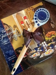 The Gathering of Friends Cookbooks available at The Schaefer House.  Pair this up with our fun colored spatula and you have a perfect gift!