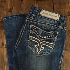 💋Rock Revival Liberty Bootcut Jeans Women Size 25 Rock Revival Women's Liberty Bootcut Jeans. Size 25 x 33 (long inseam). Studs and leather embellishments on pockets. Great condition. Small ink stain on front left just below pocket (see photo).  🎉I'm trying to purge my closet so make an offer 😊🎉 Rock Revival Jeans Boot Cut