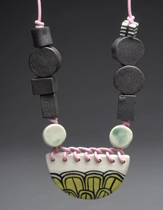 """Megan Bogonovich, Necklace in glazed ceramic and leather cord. Necklace is 26"""" in length (adjustable). Center bead measures 2.75 x 1.5 x 0...."""