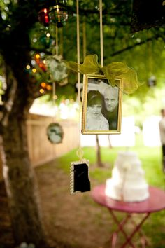 Wedding decorations for cheap:  fairy lights in the trees, and small, black and white photos of the bride and groom, framed in decorative jeweled frames and hung from the trees with thin, satin ribbons....this was your idea, Kimmy - it's only fair you get the credit!!
