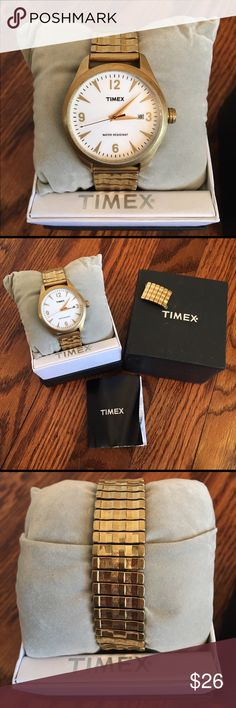 Timex '50s gold stretch band watch Just needs a new battery. Worn a handful of times. Comes with additional links. Instruction booklet has seen better days, but still serves it's purpose. Timex Accessories Watches