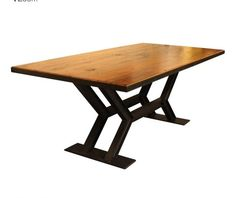 Dining table made from reclaimed wood and reclaimed i-beams as legs