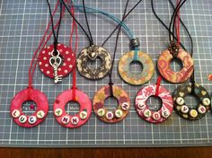 A nice tutorial on how to make these cute washer necklaces. You don't need to use scrapbook paper to make them, you can use any kind of pretty paper like gift wrapping, vintage book pages or sheet music, or even home decorated paper.