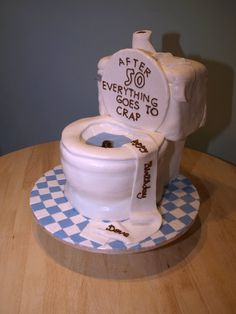 50th birthday cake idea featuring a toilet.  Everything goes to crap after 50 or so they say.  See more 50th birthday cakes and party ideas at www.one-stop-party-ideas.com