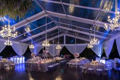 Lovely in its simplicity, pipe and drape can make ANY space gorgeous and ethereal. Beautiful hanging chandeliers and theatrical lighting really helps set the classic feel for this special event.